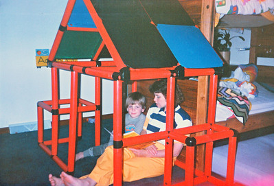 joe and mom in red play house