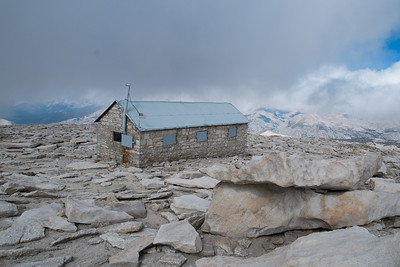 The clouds are barely above the level of Whitney.  It's eerie and very cold on top.  This is the emergency hut