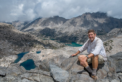 Sitting atop Glen Pass with Rae Lakes in the far background.  This was a short break of sunshine before hail and lightning came in on the descent.