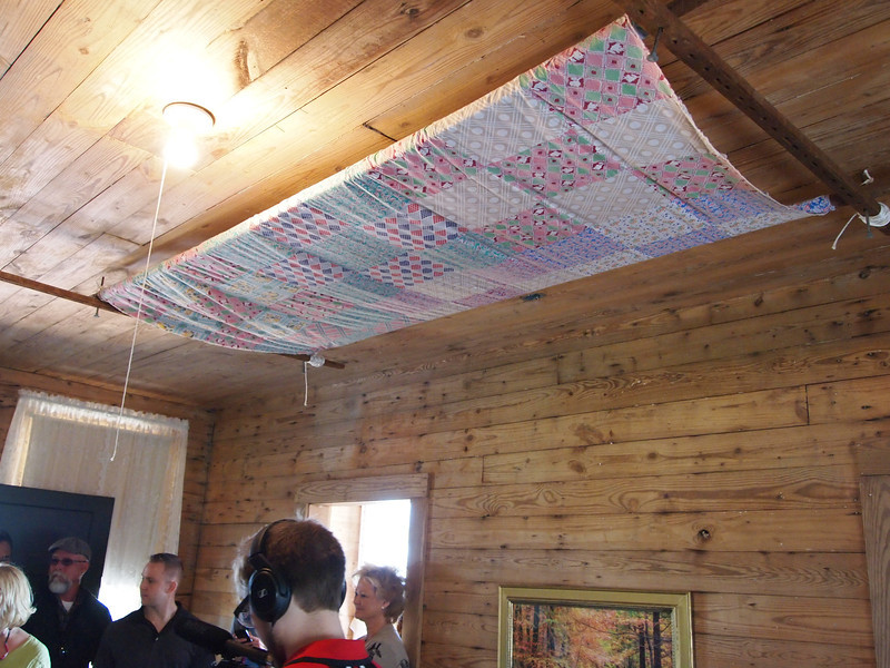 Inside the home of my grandparents, Ray and Carrie Cash, in Dyess, AR. The quilt is stretched on a frame that can be raised and lowered as necessary.