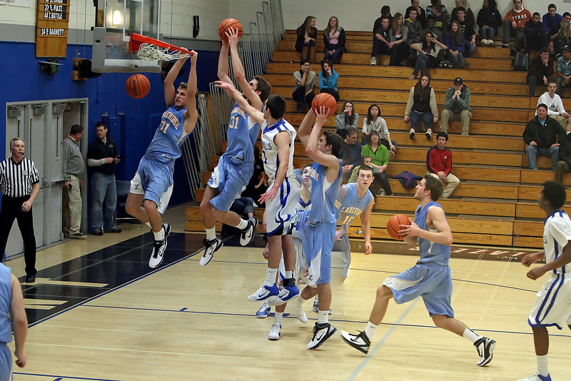 Four photographs spliced to gather for one of Michaels dunks in a play-off game his senior year of high school.