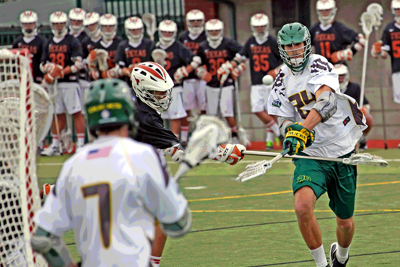 #24 Michael Hoch fires a shot for University Of Oregon Lacrosse.