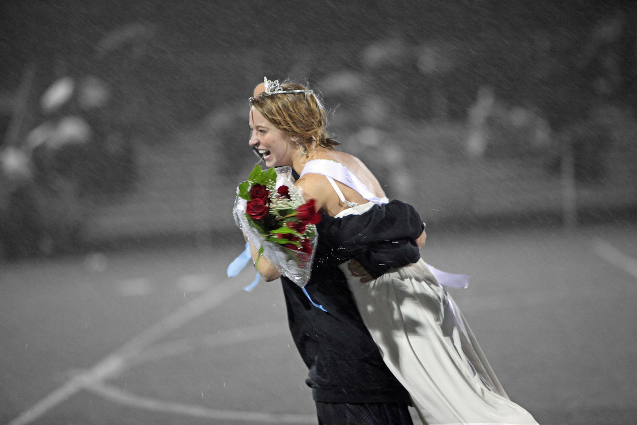 A friend's daughter wins Homecoming Queen during a rainstorm and is congratulated by her younger brother.