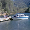Matthew McChesney, standing on the dock, while chris is on the boat.  Whiskeytown Lake, ~summer 1991.