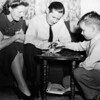 David Hauser plays a mean game of checkers with his parents.