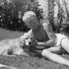 Mike McChesney and his dog Ginger on the side lawn at 10505 South St. Andrews in Los Angeles.