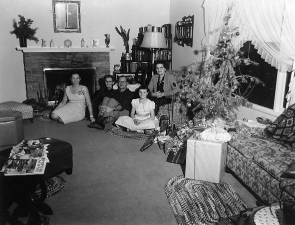 A Johnson Christmas.  Not sure if this is 921 Link Lane, Santa Rosa or, Oroville, CA.  My bet is 921 Link Lane.  From the left: (on the floor) Ruthie Johnson, Willie Cole Morrill, Arvid Cole, Susan Johnson.  Seated on the chair, Florence N. Johnson.  I would believe Glen Johnson was taking the picture.