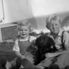 Marc and Michael McChesney with their frist dog, Tuffy.  Tuffy left rather quickly after he chewed up a pair of Dad's shoes