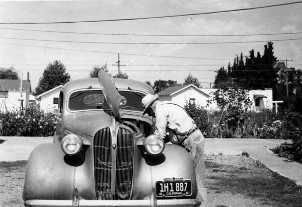 """Art Johnson works on his car at Link Lane.  He would put in $2 of regular gas and then $2 of premium to """"sup"""" up the regular.  This was his last car"""