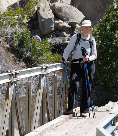 Carolyn Nelson on the bridge over Wapama Falls in Hetch hetchy, May 2011.  A month later, at this bridge, two men lost their lives trying to cross it after a heavy rain storm and unusual snow melt in June.