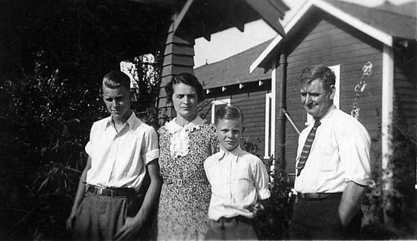Florence and Arthur Johnson with Neil and Glen.  Love Grandpa with his hands in his pockets!