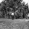 Earl Morrill, standing on the south side of 919 Link Lane.  Actually, the ground in front of him, is where Donald E. Johnson built a house, 915 Link Lane, and Lois Ruth McChesney purchased the house in the fall of 1957