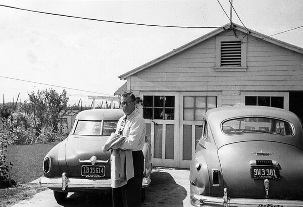 Walter Stansberry at 919 Link Lane, ~1951. I love the old Studabaker and DeSoto. On the left hand side, you can see the old hop fields that were in West Santa Rosa.