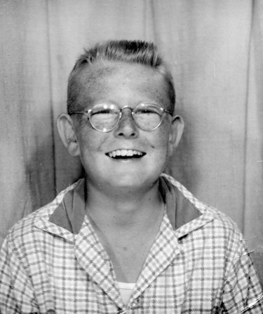 "Michael M. McChesney ~12.  Lots of freckels.  More than likely, stole 25 cents from my dad to put in a photo machine.  After looking at countless pictures, I finally figured out where my ears came from--Grandpa Johnson! I was known as ""mud flaps"" when I worked in the bowling alley."