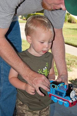 Dad show Liam the bubble machine.  I never had one of those.  June 27, 2011.