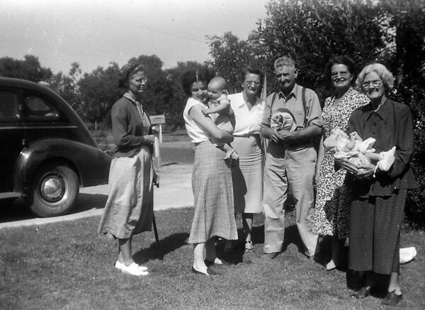From the left. Aunt Willie. Barbra Cole (?) with child, Clara Stansberry, A. E. Johnson, Florence Johnson, and Grandma Cole with baby.  This is how I remember Grandma Cole when we used to stop in Santa Maria to visit her and Uncle John.  Barbra Cole married a Marvin, but I can not remember his last name.<br /> Florence is my grandmother, while Grandma Cole is my great grandmother.