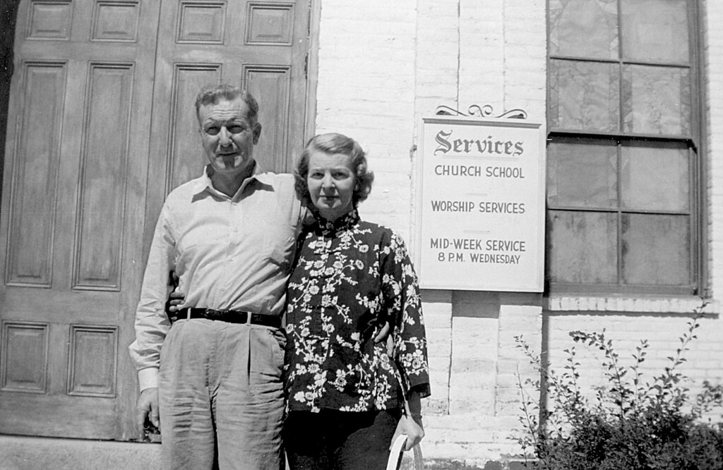 Homer M. and L. Ruth McChesney Stand in front of the Carson City, NV church where they were married, July 1956