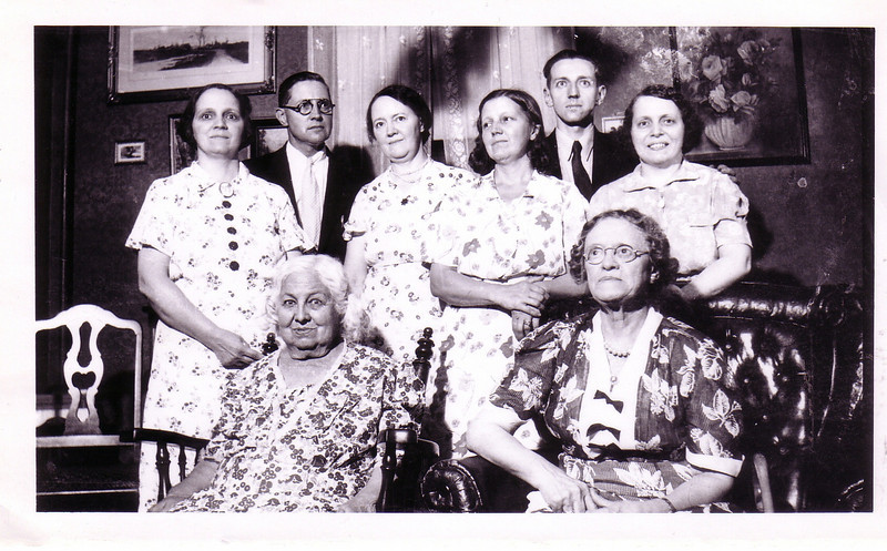 The Smith Family at Aunt Hattie Clark's 1937  Holyoke, Mass<br /> Back Row:  Charles Effingham Smith, Herbert Lester Smith (Uncle Bert)<br /> Middle Row: Angie, Ellie, Fanny, Gladys(Grandma Johnston)<br /> Front Row:  Mother Myra Smith White and Aunt Hattie Smith Ainsworth Stebbins Clark  (Next photo has handwritten notes)