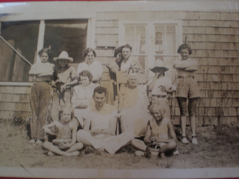 Bill center front, Gladys seated behind him, Ma Smith seated with Bert and Dee Smith behind her, Dorothy Johnston far right so Doug is one of the ones in the hats