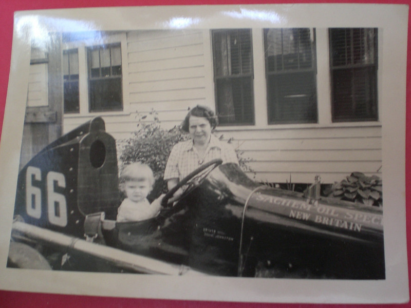 Dee Dee and her grandmother Gladys with Doug Johnston's race car at 91 Newhall St.