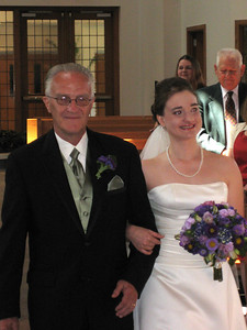 Katie escorted down the aisle by her father