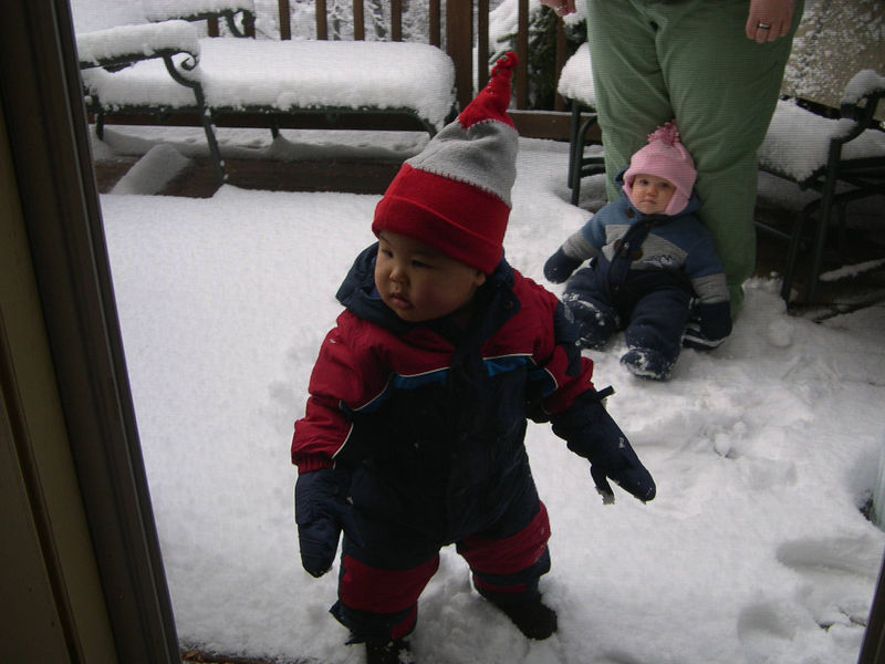 Jonathan in his new snow suit.  Baby Cara and the nanny are in the back.