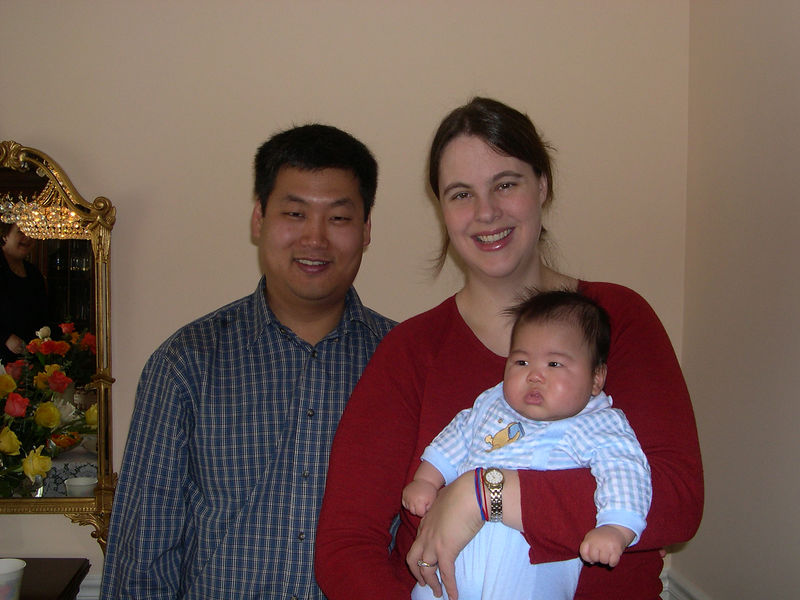 The proud parents and Jonathan at 100 days old.