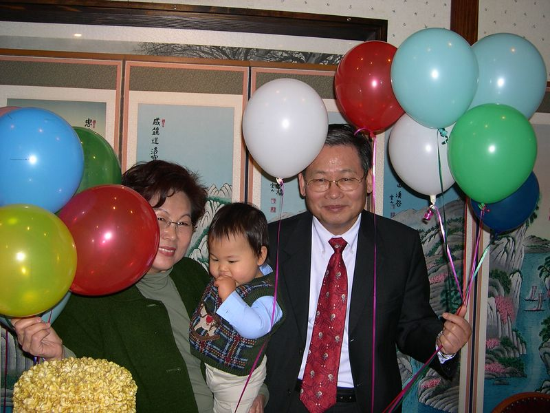 Grandparents Peter and Sandy Kwon enjoy Jonathan's first birthday celebration.