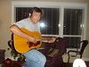 Uncle Ron rocks out with his new Guitar - Curt/Jerica