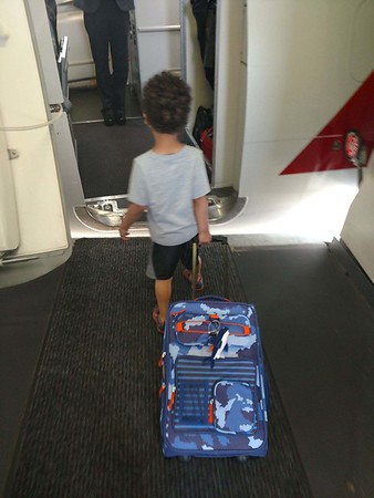 Boarding plane with new suitcase.