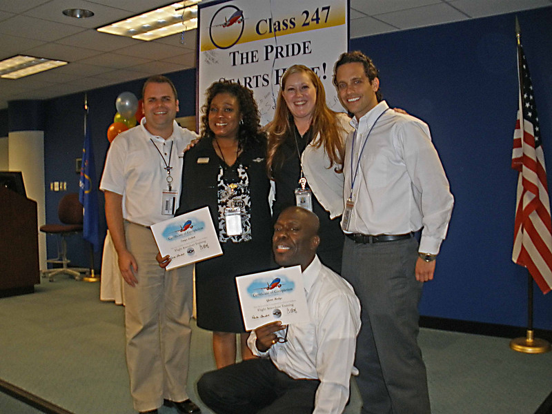 New Baltimore Flight Attendant Managers and their Director (2nd from right)