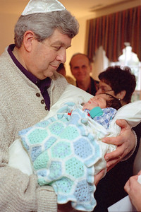(Maternal) Grandpa Gerry Libman holds his first grandson, Joshua Berenzweig at his bris, November 1997, Rockville, MD Friend Jesse Reuben and paternal grandmother Sandy Berenzweig in background.  Shot on Pentax ME Super  Kodak Gold 400-5, frame #21 (roll 1997-11) Scanned with Minolta Scan Dual II in June 2016