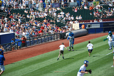 Then they had to try to run down to the mascots and back while their heads were still spinning!