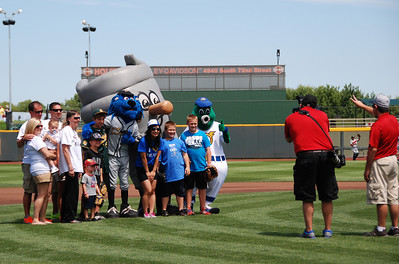 Getting a group photo of everyone who threw the first pitch.