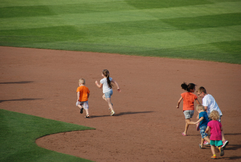 Emma running the bases after the game.