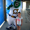 Emma with Stormy, one of the team mascots.