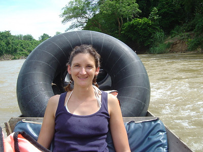 travelling up the river with our tubes in preparation for tubing down it again!