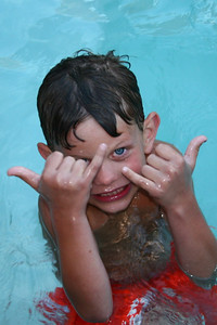 Tyler throwing up the Shaka in the pool