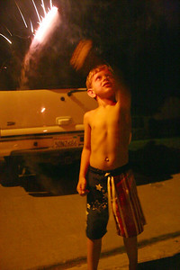 Tyler waving a sparkler in celebration of Independence Day, 2007