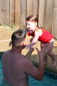 Jill jumps to Ryan in the pool