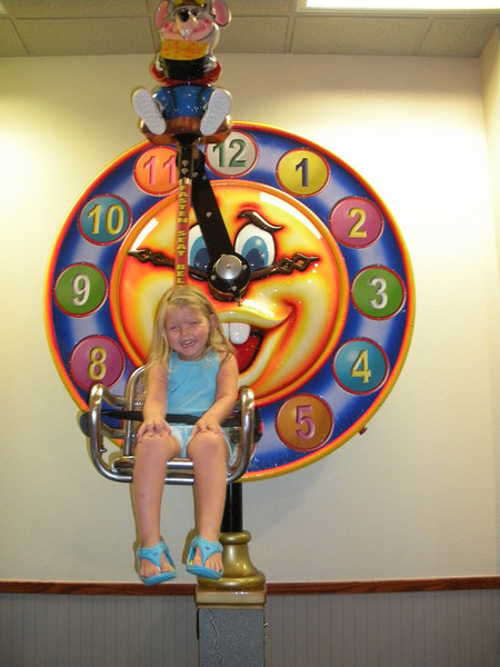 We took Camden and Claire to Chuck E. Cheese for dinner.  The first thing Camden wanted to ride was the clock.