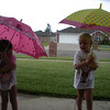 Playing outside in the rain with their umbrellas...at least until the lightening showed up.