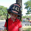 The firemen were at the end of our parde and they let the kiddos try on their equipment