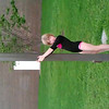Lila after gymnastics class, climbing a pole