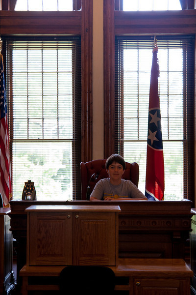 Thomas sits at the original desk from the Scopes trial.