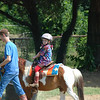 She had a great week of riding horses, looking for chicken eggs, and lots of fun crafts