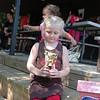 Admiring her trophy