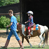 Hallie riding Tucker at end of buckaroo camp rodeo