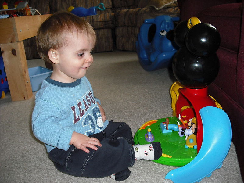 Enjoying playing with Mickey Mouse