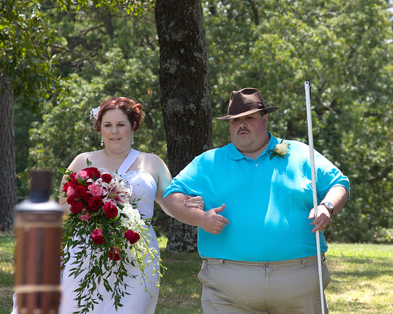 Kara and her Daddy coming down the aisle
